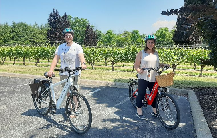 Ebike riders smiling in a vineyard
