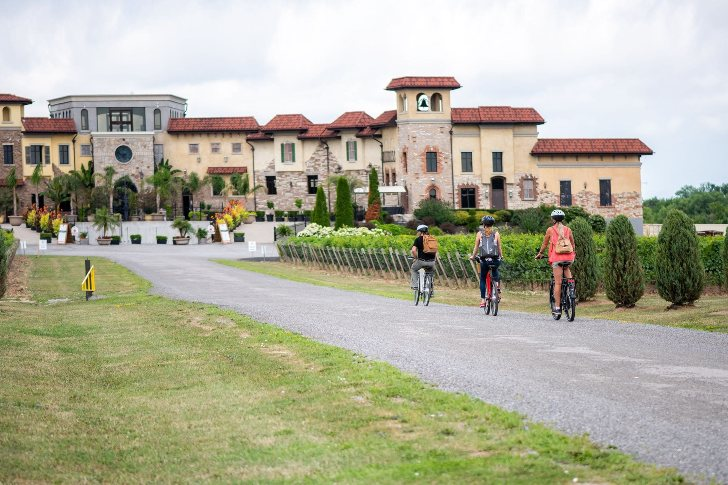 Ebike riders arriving to large winery