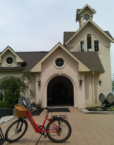 Red bike in front of Beamsville Church