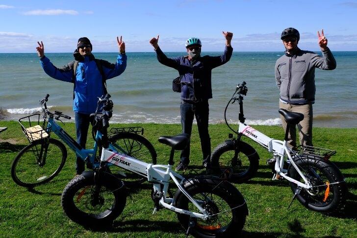 3 men on an Ebike next to Lake Ontario